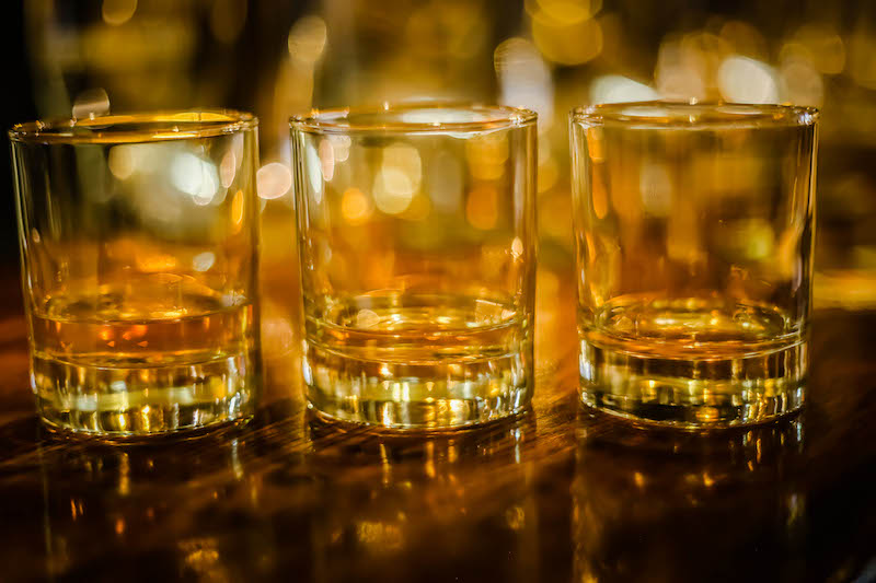 Three tumbler glasses with Scotch whisky