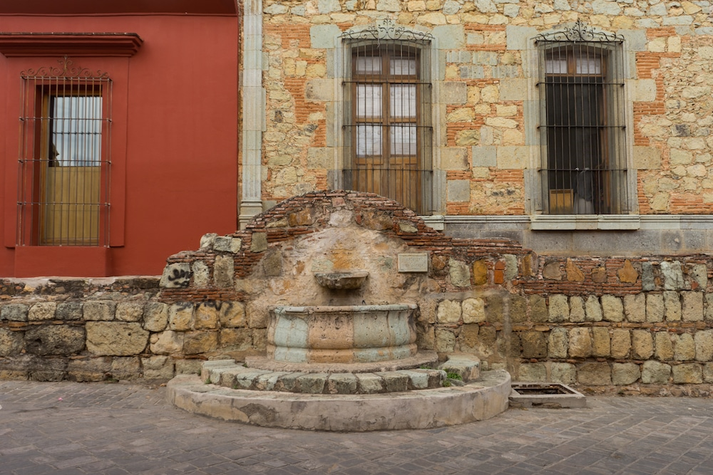 old fountain colorful wall oaxaca