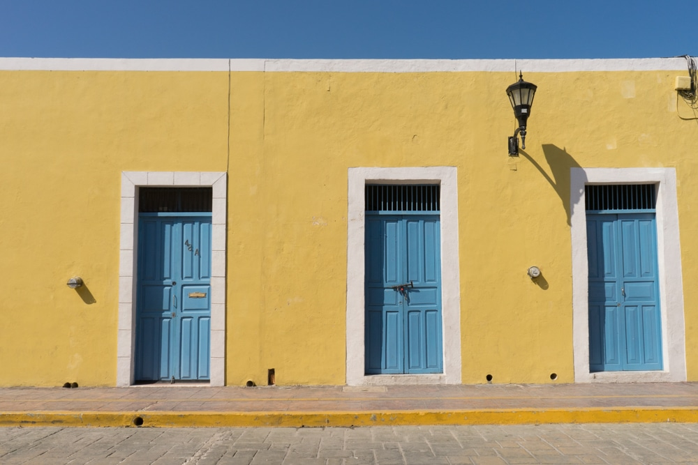 yellow building with blue doors campeche mexico