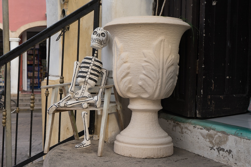 A skeleton and planter Valladolid Mexico