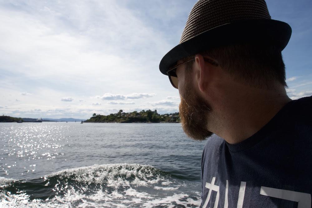 A man on a public ferry in Oslo Fjord
