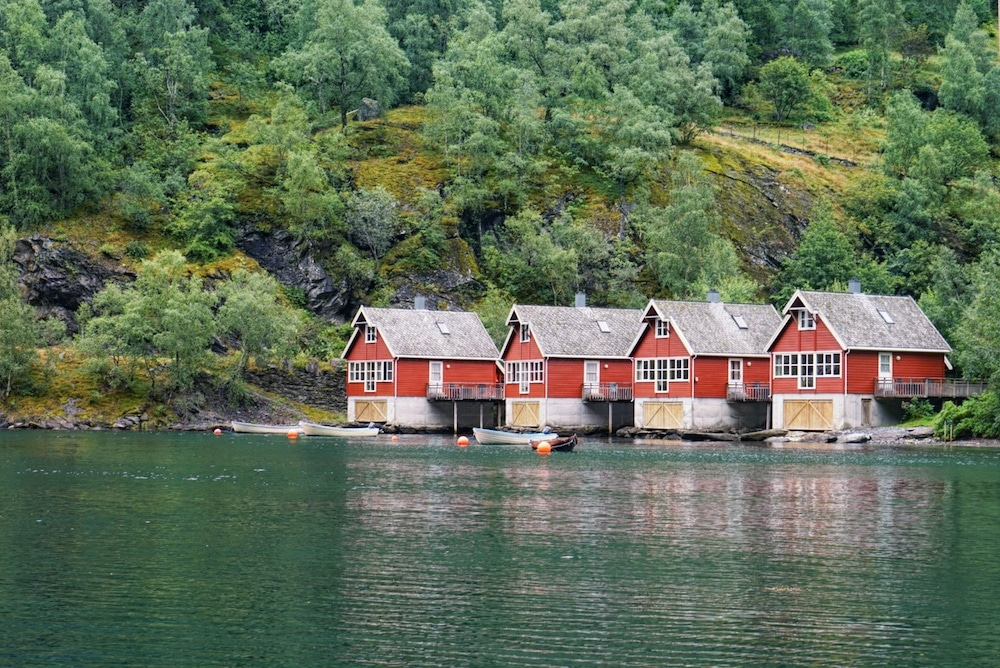 Bright red buildings on a Fjord in Norway