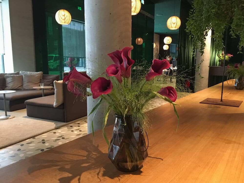 Bar in the Zander K Hotel Bergen Lobby Area Flowers