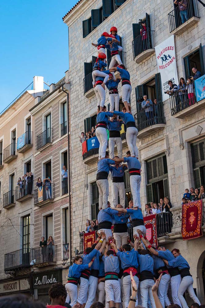 things to do in girona spain, watch human castles being built