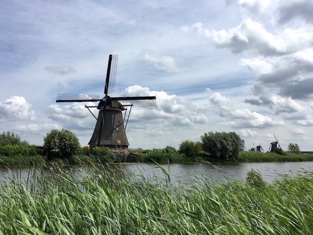 Along the river to the windmills is one of the Cool things to do in Rotterdam