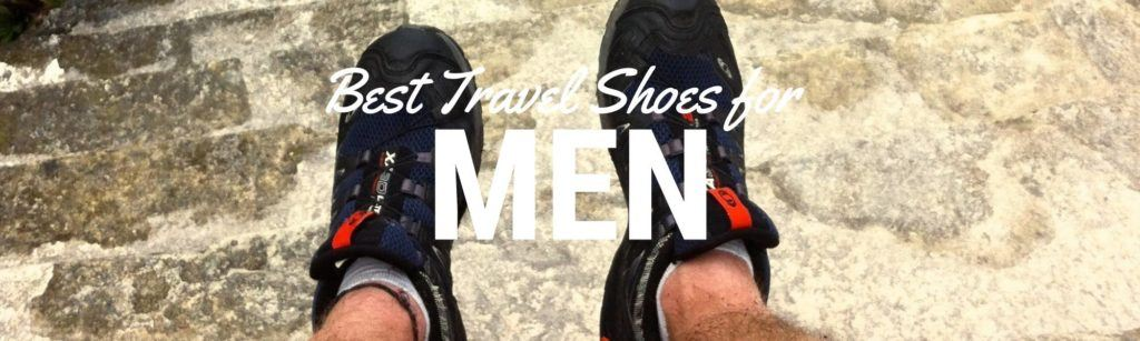 "Header image for a blog about best travel shoes for men. Image shows a close up of men's feet wearing hiking shoes. The words ""best travel shoes for men"" are laid over top the image"