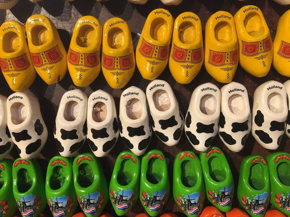 A detail of colorful wooden shoes on a wall in the netherlands