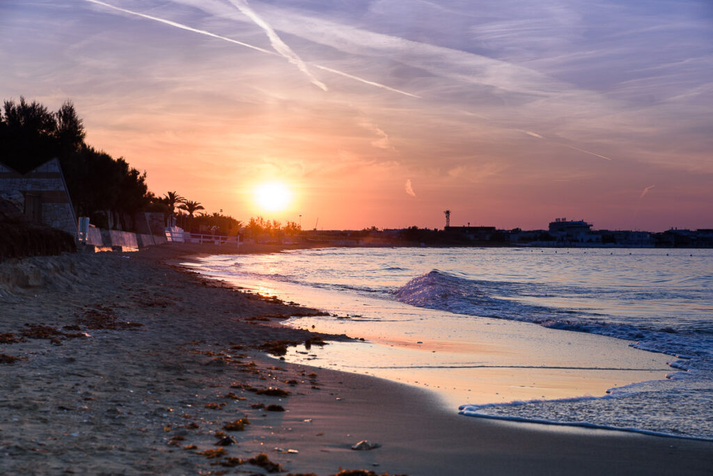 sunset over the beach in torre canne, puglia, italy