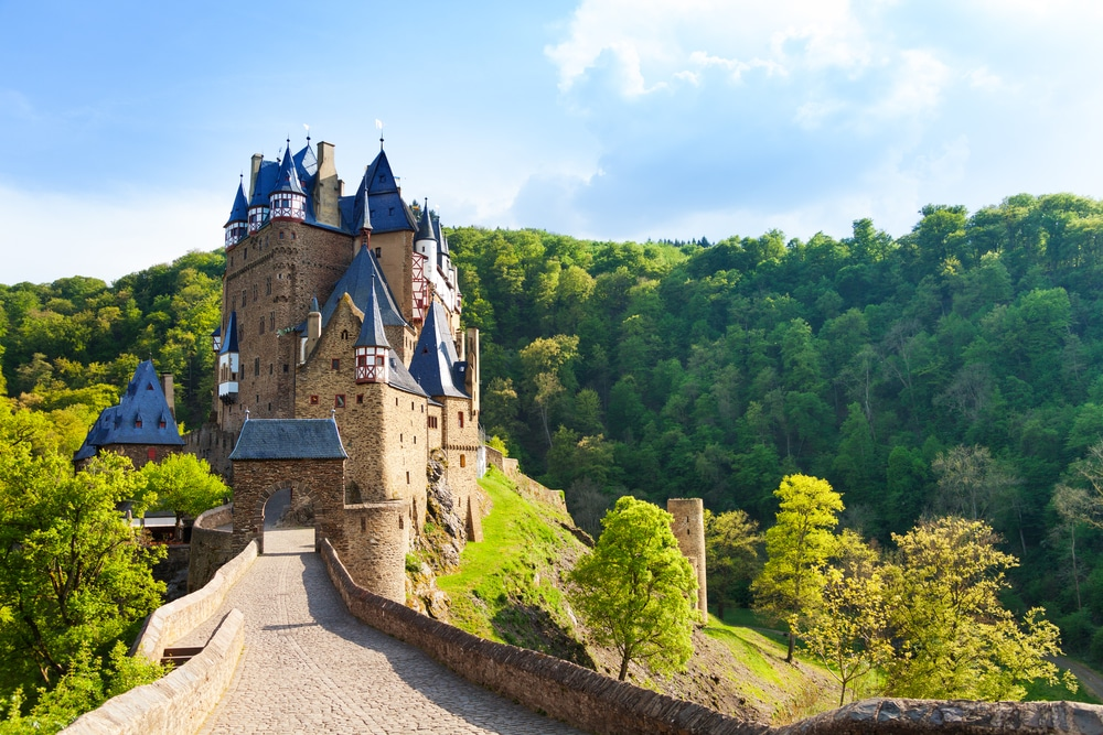 Road to the Eltz castle with towers in the forest, Rhineland-Palatinate, Germany, Europe