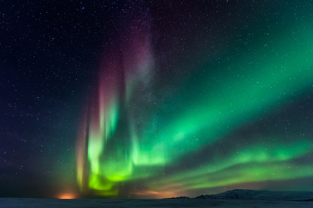 Northern lights above snowy plain