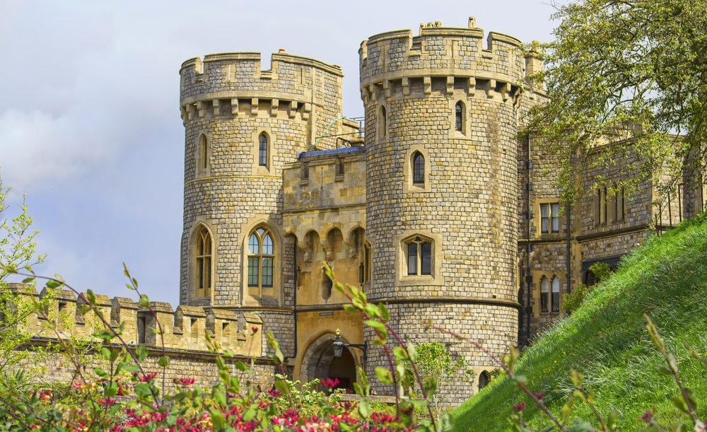 Windsor castle in the summer with flowers in the foreground.